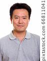 Studio shot of Japanese man isolated against white background 66811041