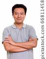 Studio shot of Japanese man isolated against white background 66811458