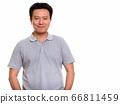 Studio shot of Japanese man isolated against white background 66811459