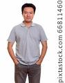 Studio shot of Japanese man isolated against white background 66811460
