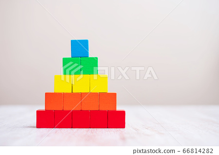 Colorful wooden cube blocks on table background 66814282