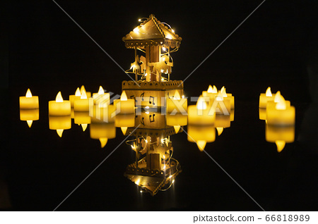 Toy carousel under night light.In the yellow light, a carriage carriage music box.Reflecting the shadow like floating in the middle of the lake.select focus       66818989
