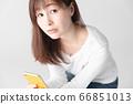 Smartphone, female, white background 66851013