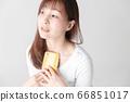 Smartphone, female, white background 66851017
