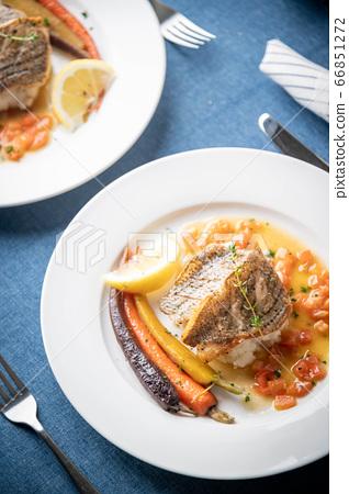 sea bass poele with white wine sauce, luxury 66851272