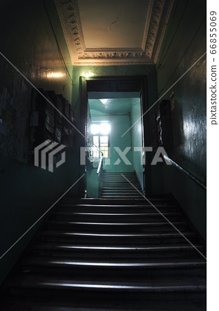 Staircase at the entrance. Public entrance to a residential building. 66855069