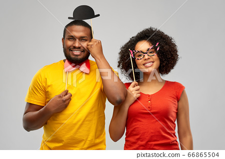 happy african american couple with party props 66865504