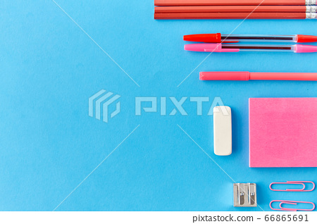 pink sticky notes, pens, pencils, clips and eraser 66865691