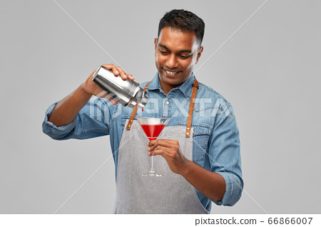 indian barman with glass of cocktail and shaker 66866007