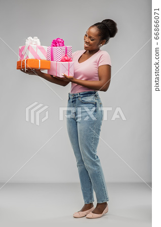 happy african american woman with gift boxes 66866071
