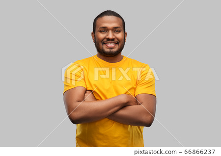 smiling african american man with crossed arms 66866237