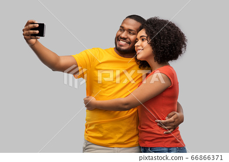 african american couple taking selfie by cellphone 66866371
