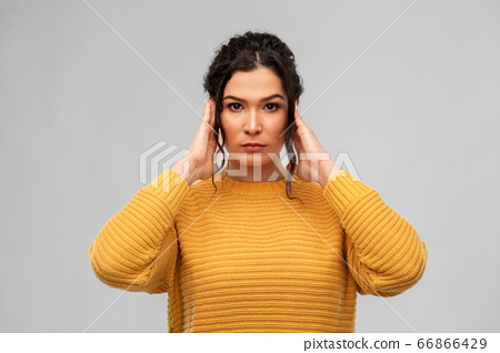 serious woman closing ears with hands 66866429