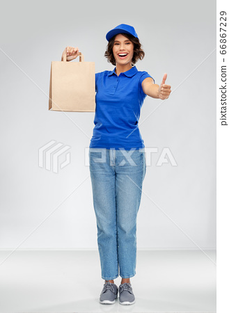 delivery woman with paper bag showing thumbs up 66867229