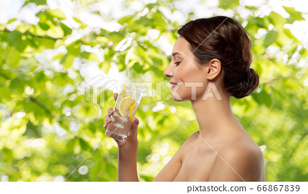 woman drinking water with lemon and ice 66867839