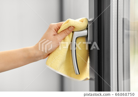 hand cleaning window handle with microfiber rag 66868750