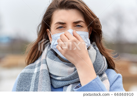 young woman wearing protective medical mask 66868910