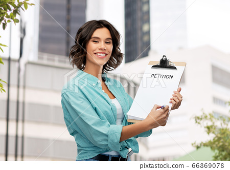 smiling woman with petition on clipboard and pen 66869078