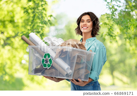 happy smiling young woman sorting paper waste 66869171