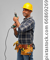 happy indian builder in helmet with electric drill 66869269