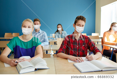 group of students in masks at school lesson 66869332
