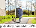 woman in mask and gloves with dog walking in city 66869894