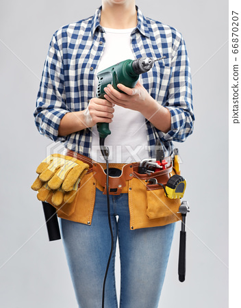 woman or builder with drill and work tools 66870207