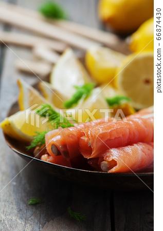 Smoked salmon with grissini and lemon 66874430