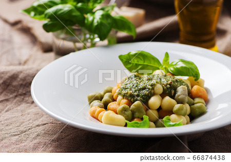 Colored gnocchi with pesto 66874438