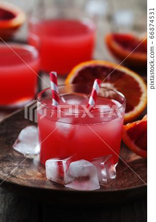 Fresh red orange juice in a glass 66874531