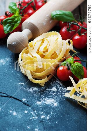 Uncooked italian pasta on the table 66874799