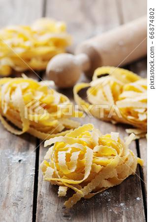 Uncooked italian pasta on the table 66874802