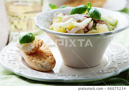 Healthy salad with octopus, celery and potato 66875214