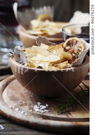French fried potatoes with lemon and rosemary 66876259
