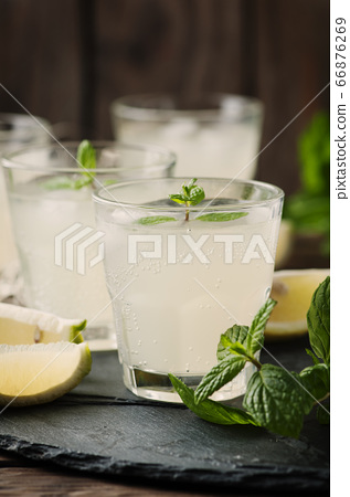Fresh cocktail with lemon, ice and mint on the 66876269