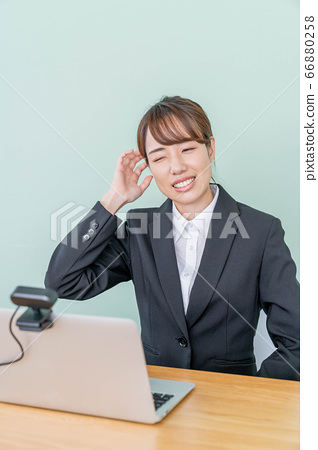 A young woman interviewing online using a webcam [Failure in job hunting] 66880258