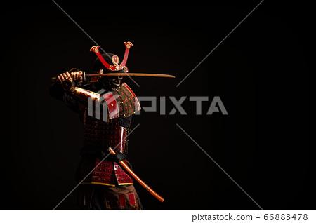 Portrait of a samurai in armor in attack position 66883478