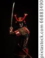 Portrait of a samurai in armor in attack position 66883490