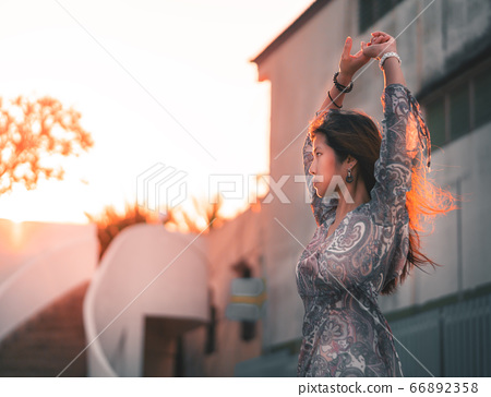 Woman portrait with hard sunflare on with Beach 66892358
