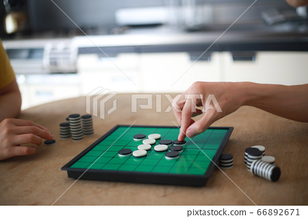 Couple playing on Othello 66892671