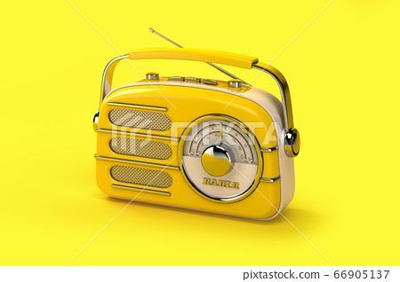 Yellow vintage radio on yellow background. 66905137