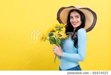 Young woman with sunflowers 66914025