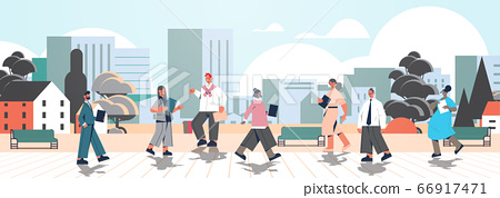 mix race businesspeople with folders walking outdoor business people office workers in urban park 66917471