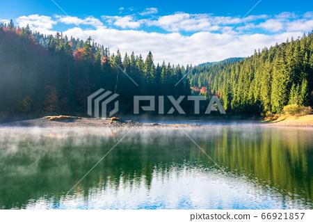 lake landscape at foggy sunrise. misty scenery 66921857
