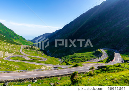 winding mountain road on a sunny day. empty 66921863