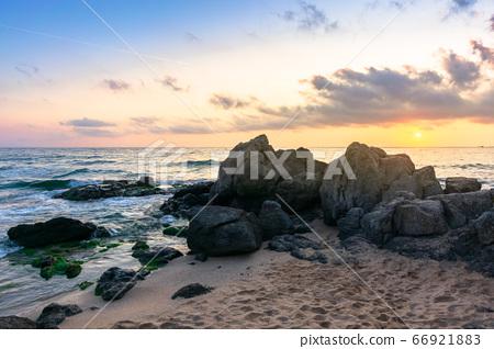 idyllic sunrise on the ocean shore. waves crashing 66921883