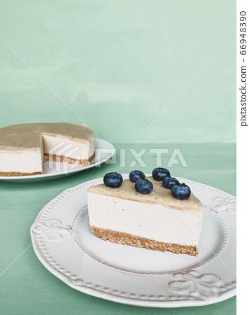 Vegan cheesecake with a salted caramel fudge sauce. 66948390