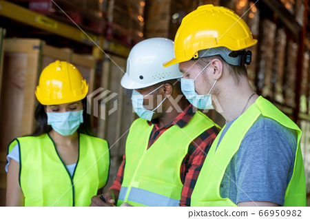 Warehouse workers wearing protective mask 66950982
