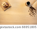 Overhead view of coffee pot and beans by cup on wooden table 66951805