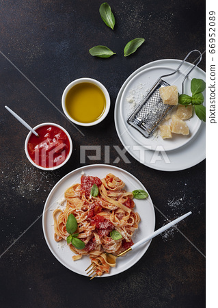Traditional italian pasta with tomato, basil and 66952089